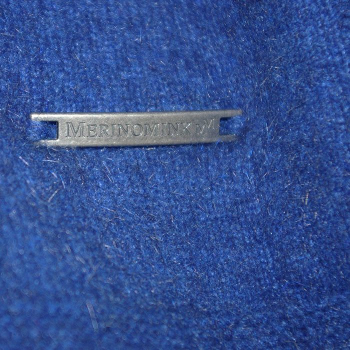 Possum Merino Lanarch Cape in Royal Blue Branding Detail